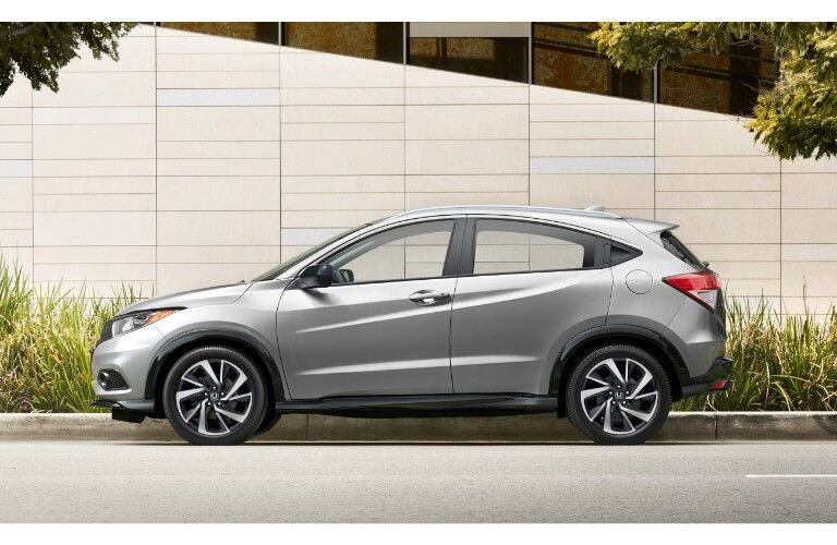 2019 Honda HR-V exterior side shot gray paint job parked next to a building, grass, and trees
