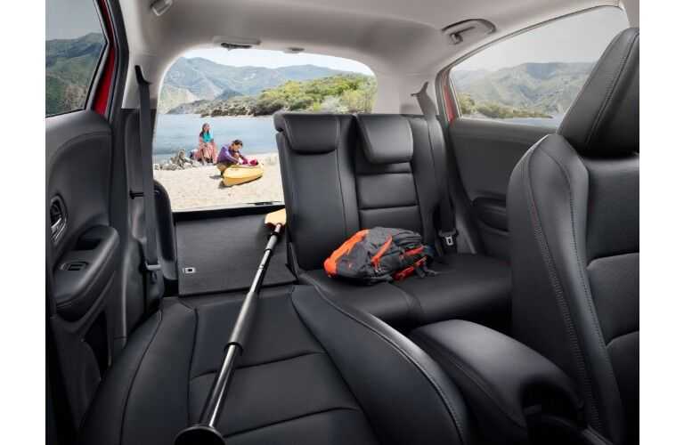 2019 Honda HR-V interior shot of back row adjustable cargo space with family outside on a beach