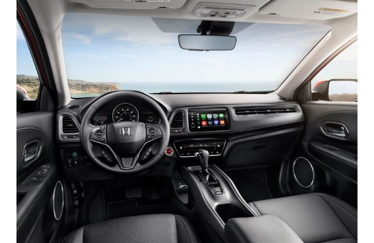 2019 Honda HR-V interior shot of front seating, transmission, steering wheel, and dashboard