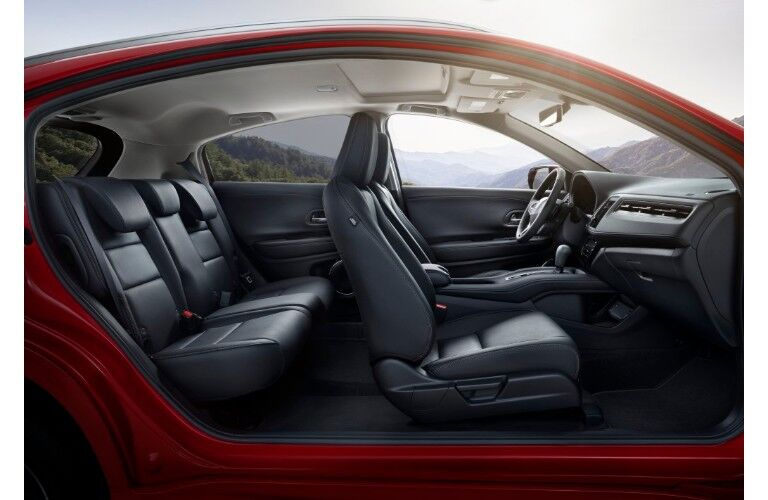 2019 Honda HR-V side shot of interior cabin seating frame and a mountain forest background