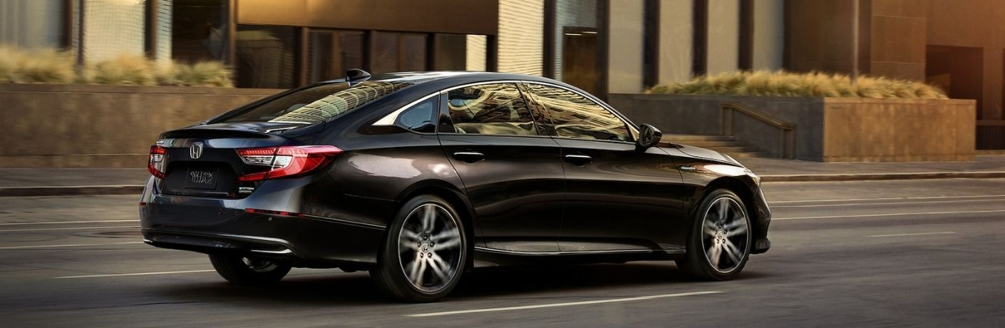 Side view of a black 2021 Honda Accord Hybrid on a road