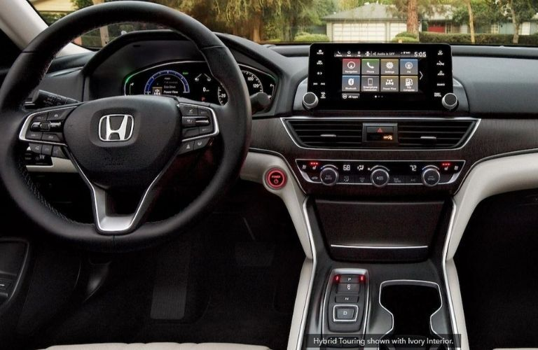 The interior dashboard and steering wheel of the 2021 Honda Accord Hybrid