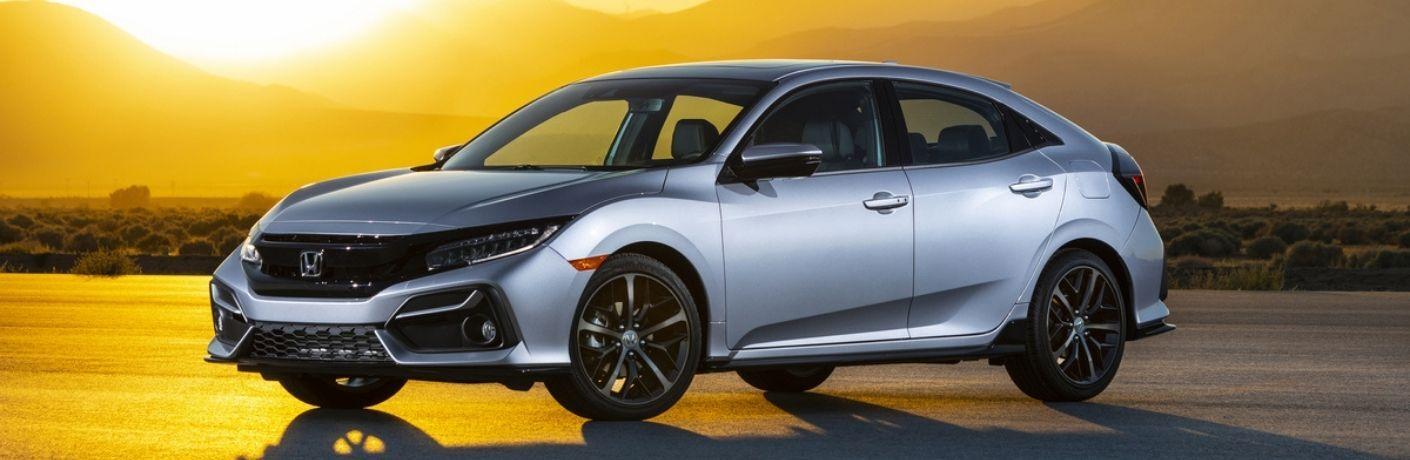 Silver 2021 Honda Civic Hatchback Front Exterior at Sunset