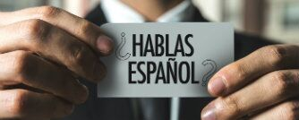 Do you speak spanish hablas espanol car held by a man in a suit