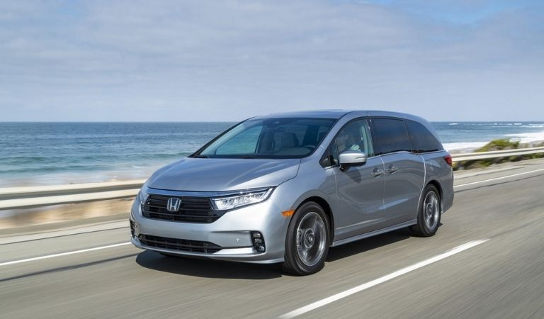 Silver 2021 Honda Odyssey on a Coast Road
