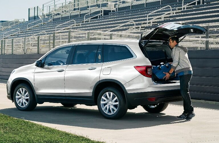 Person loading up the back end of a 2021 Honda Pilot