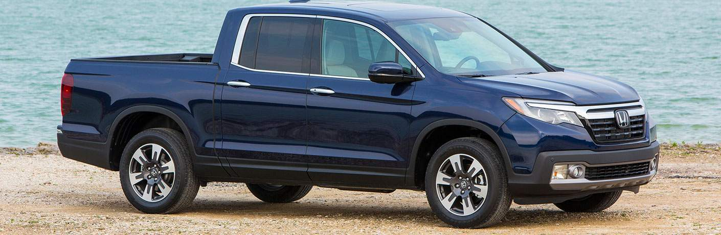 2018 honda ridgeline shown from profile on beach sand