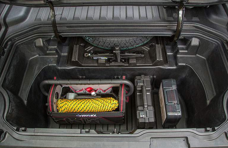 in-bed trunk on 2018 honda ridgeline shown full of gear and material that can be used