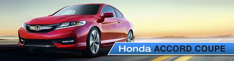 Honda Accord Coupe red driving down open road with clear sky