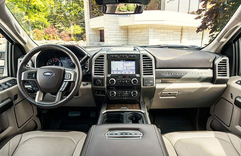 Interior of 2018 ford super duty limited showing infotainment steering wheel and front seats