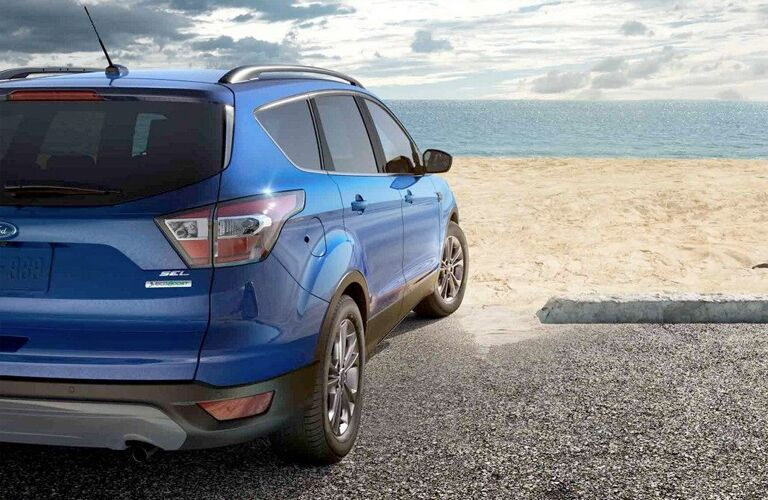 rear of 2018 ford escape in blue at beach