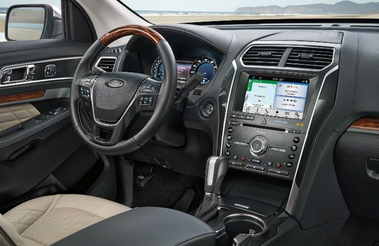 Interior of 2018 ford explorer showing off sync3 system and dashboard