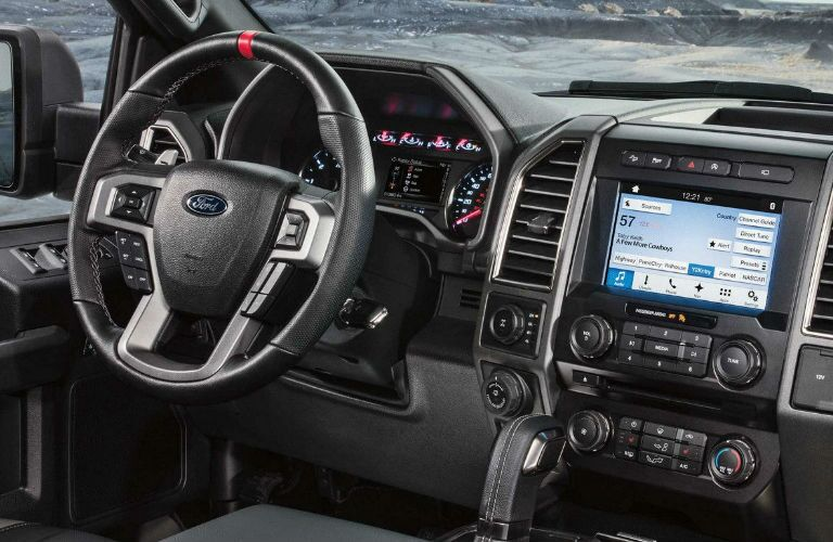 interior of 2018 ford f150 with infotainment screen and steering wheel in focus