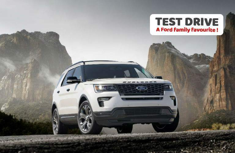 2018 ford explorer in white with overlaid text test drive a ford family favourite