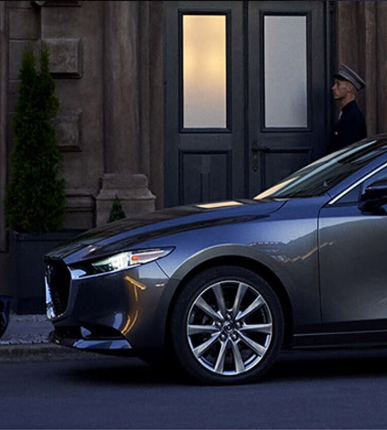 2019 Mazda3 parked in front of a building on a city street