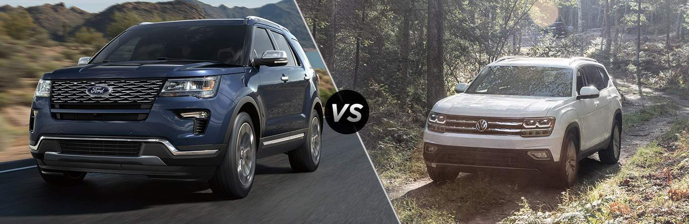 Closeup of the 2018 Ford Explorer driving by mountains vs 2018 Volkswagen Atlas parked by the woods