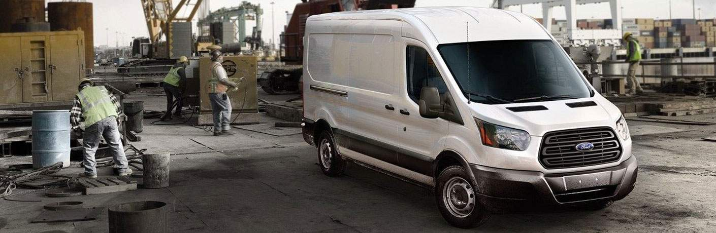 2018 Ford Transit Cargo Van White Exterior Front View with workers to the left
