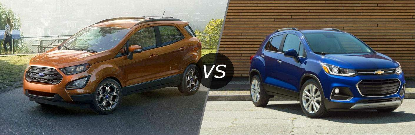 Front quarter of the 2018 Ford EcoSport parked by a park bench vs 2018 Chevrolet Trax parked in front of a brick wall