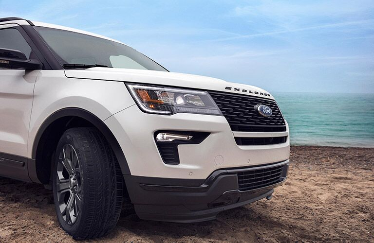 side view of front end of white 2019 ford explorer