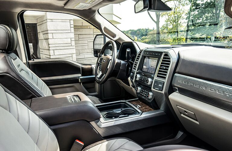 side view of front interior of 2019 ford super duty f-250 including seats and center console