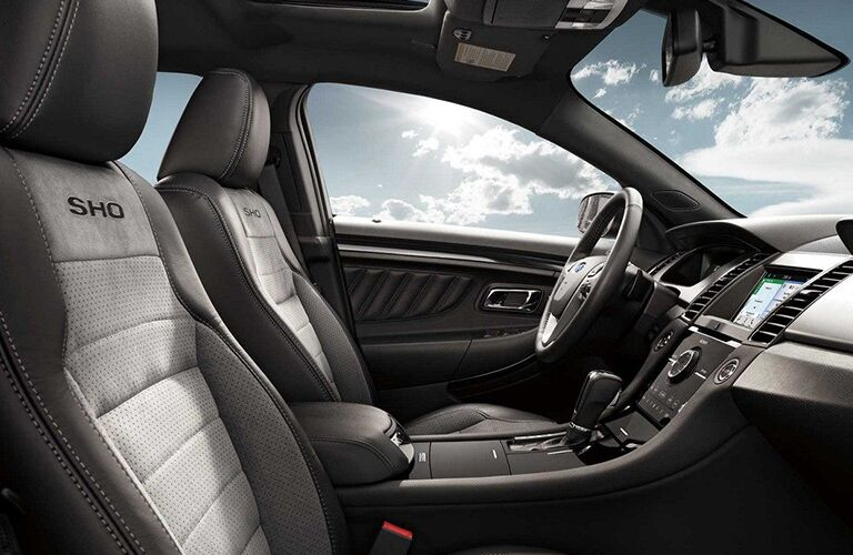 side view of front interior of 2019 ford taurus including seats and center console