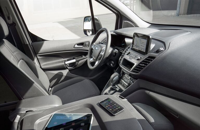 front interior of 2019 ford transit connect cargo van including steering wheel and infotainment system