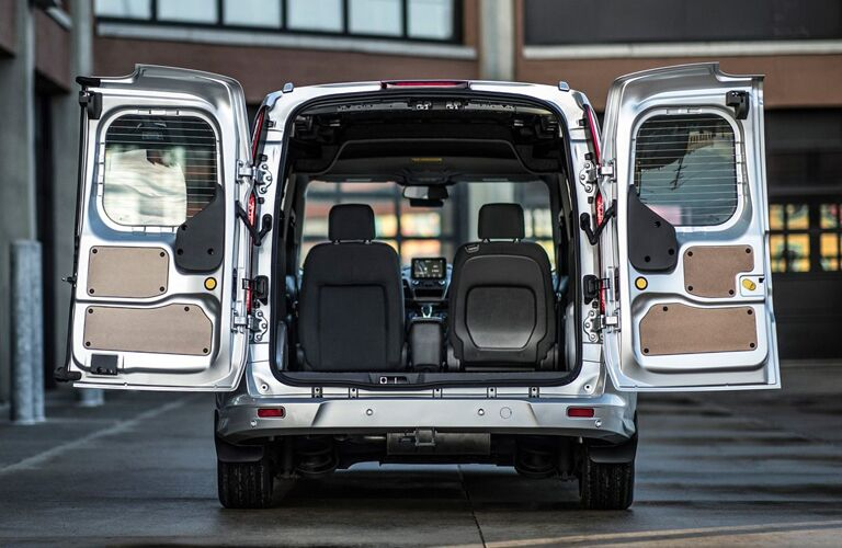 rear cargo space of 2019 ford transit connect van with rear doors open