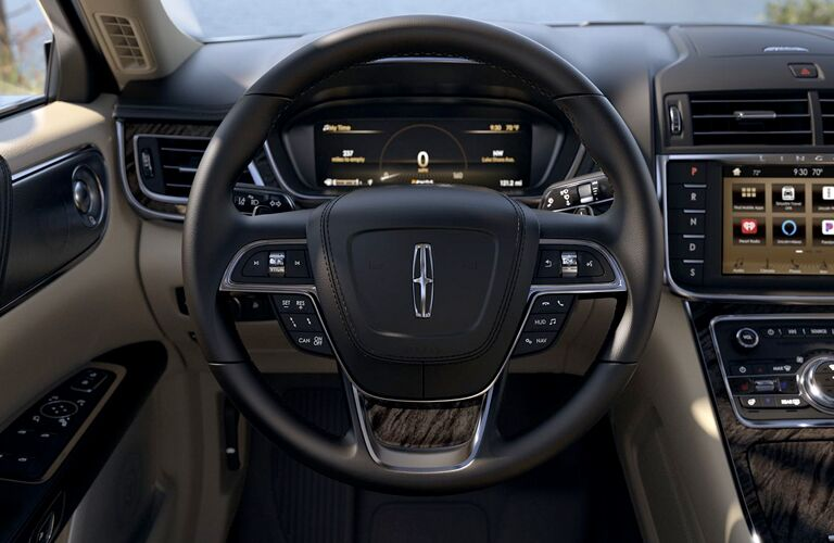 front interior of 2019 lincoln continental including steering wheel and dashboard