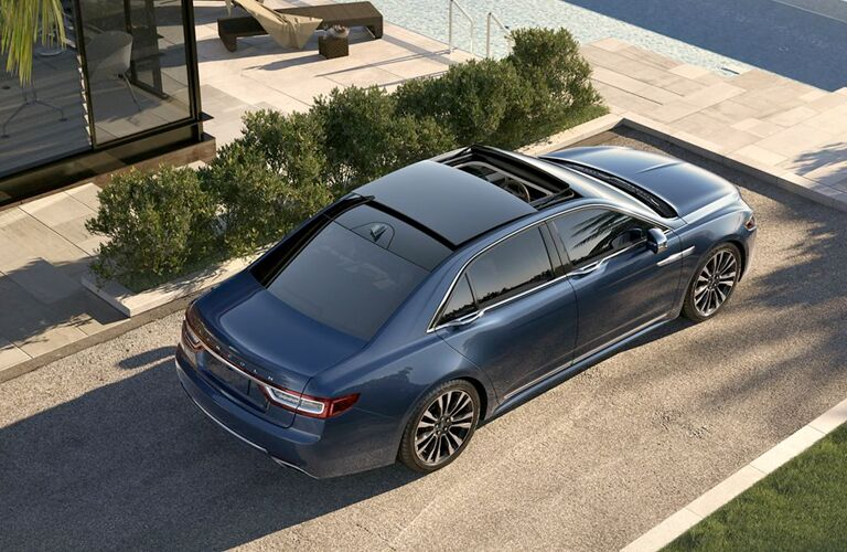 aerial and side view of blue 2019 lincoln continental opening sunroof