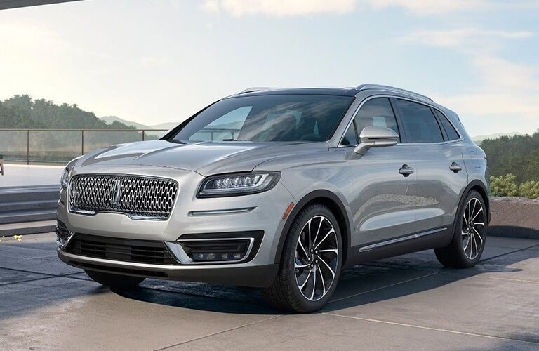 front and side view of silver 2019 lincoln nautilus