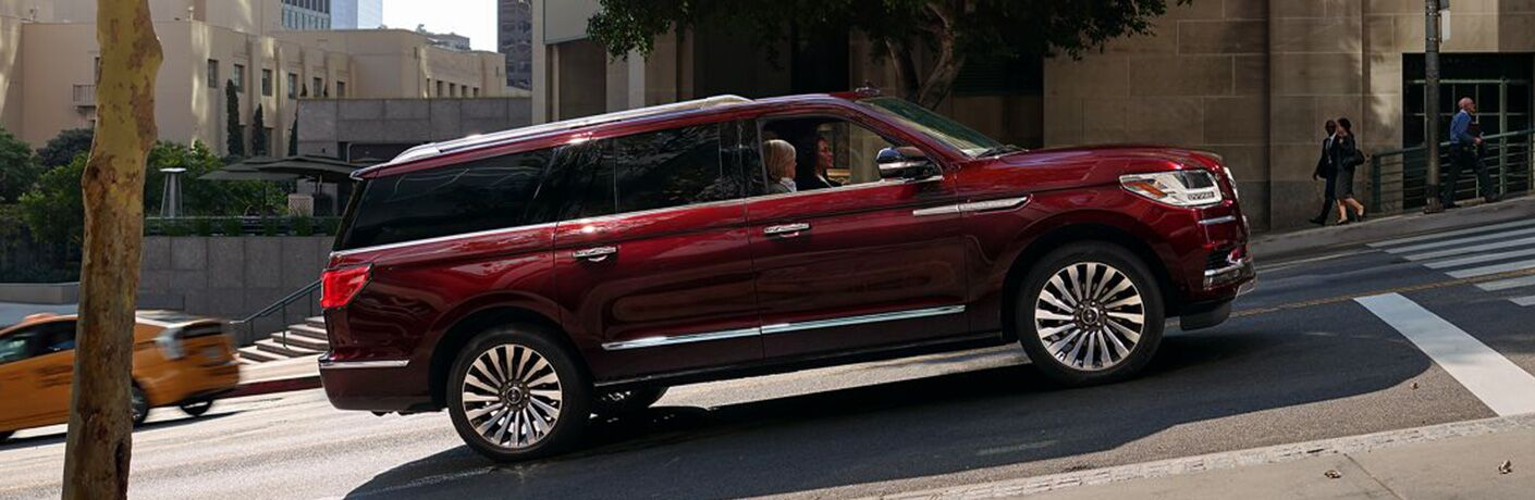 side view of red 2019 lincoln navigator