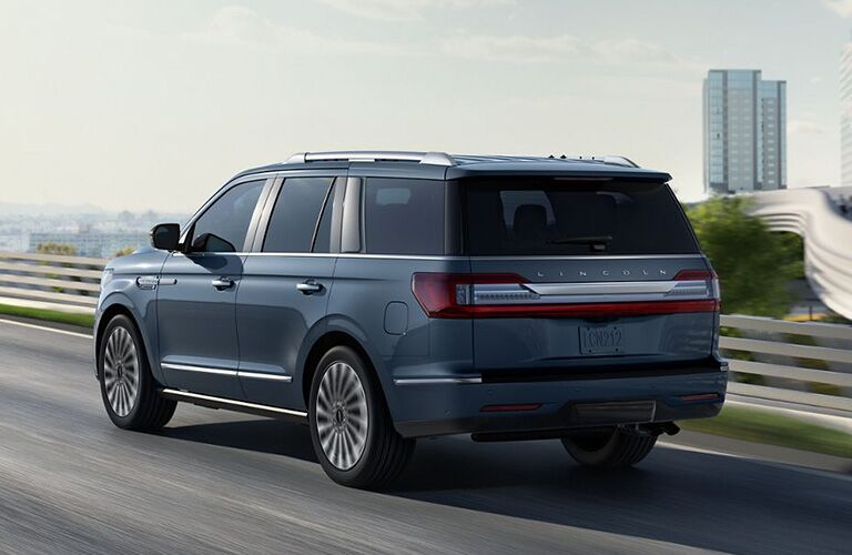 rear and side view of blue 2019 lincoln navigator