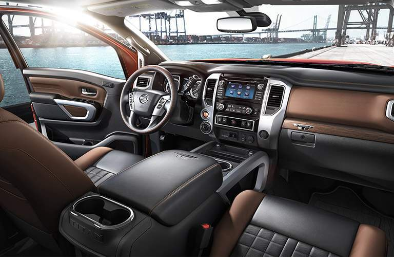 interior cabin of 2017 nissan titan xd showing dashboard, center console, steering wheel and infotainment system