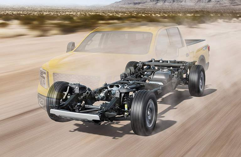 2017 nissan titan xd with body frame and chasis highlighted while driving on desert road