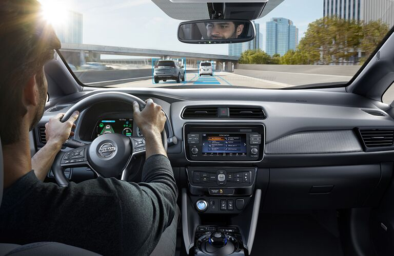 man driving 2018 nissan leaf on highway with intelligent cruise control