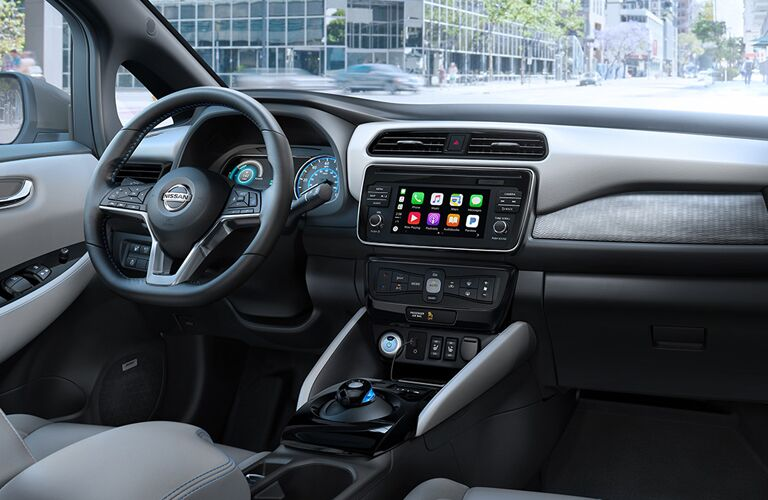 front interior of 2018 nissan leaf including steering wheel and infotainment system