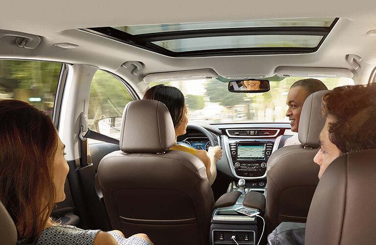 view of interior of 2018 nissan murano with multiple passengers