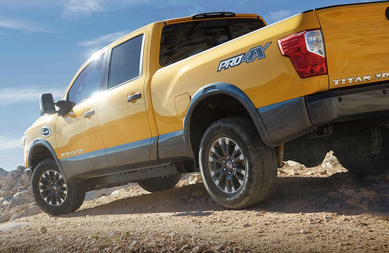 side and rear view of yellow 2018 nissan titan xd