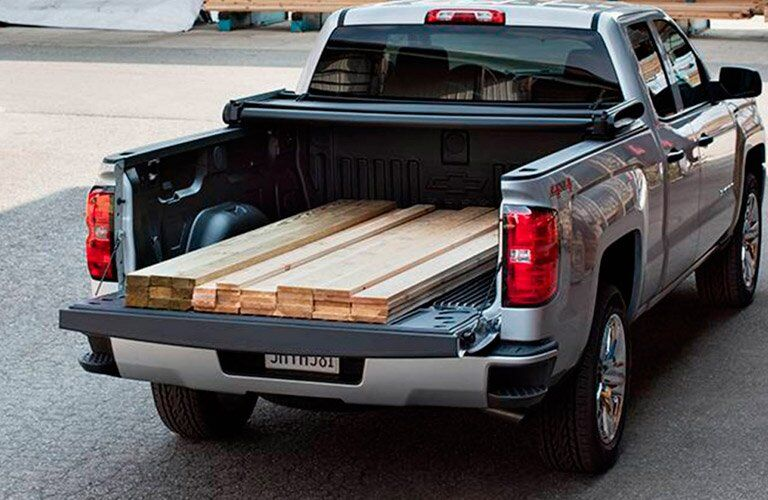 2017 Chevy Silverado 1500 loaded with lumber, seen from the rear