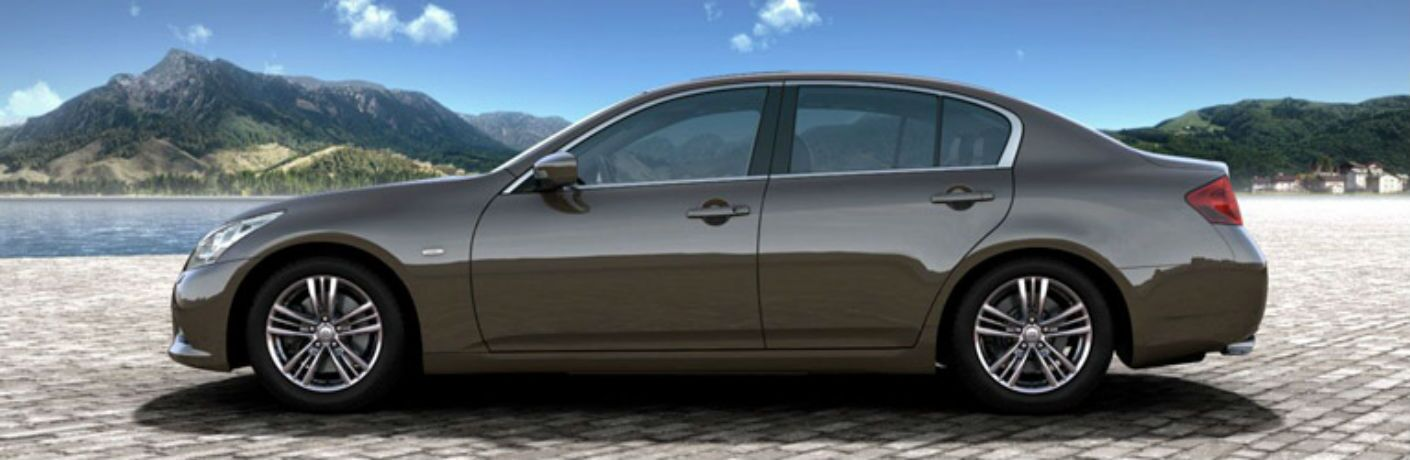 Driver side exterior view of a gray 2014 INFINITI G-Series sedan