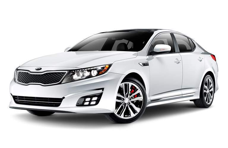 Side exterior view of a white 2014 Kia Optima