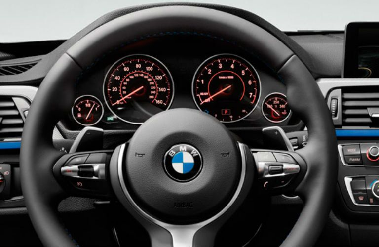 Steering wheel mounted controls and driver information cluster of the 2015 BMW 3 Series