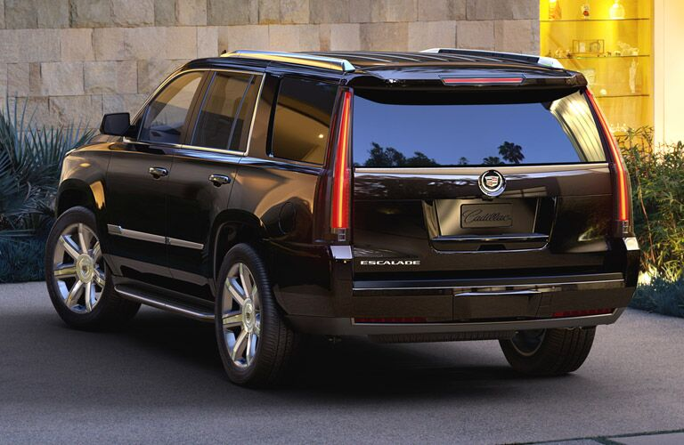 Rear exterior view of a black 2015 Cadillac Escalade