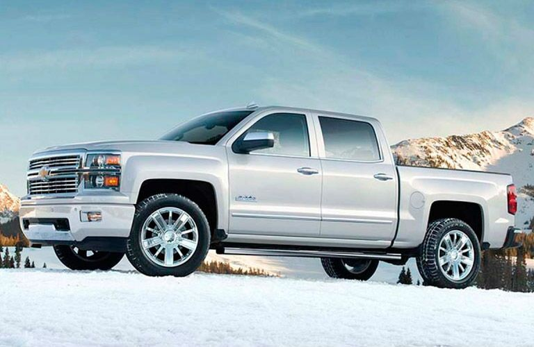 Driver side exterior view of a white  2015 Chevy SIlverado