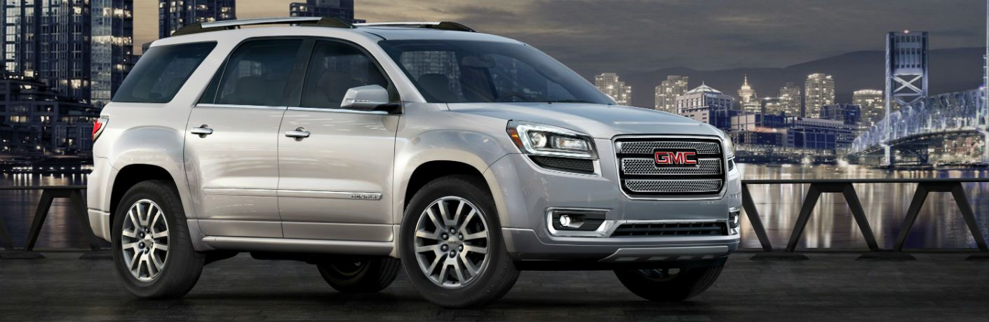 Front passenger side exterior view of a gray 2015 GMC Acadia