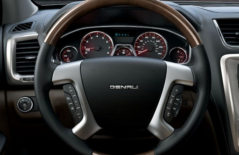 Driver information cluster and steering wheel mounted controls of the 2015 GMC Acadia