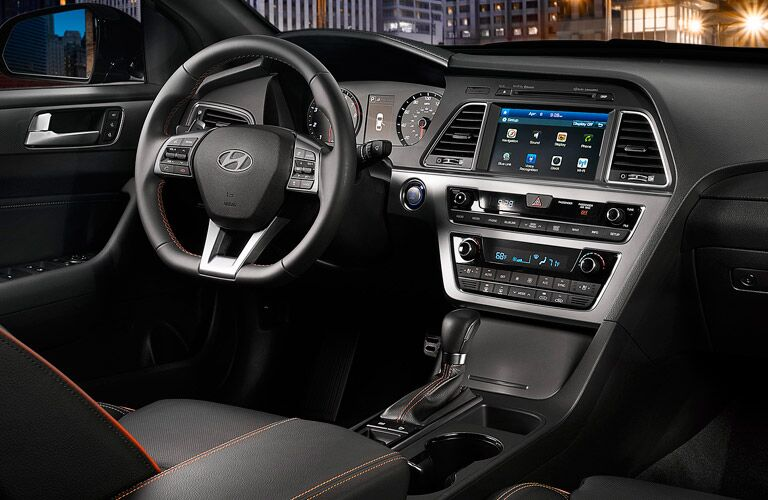 View of the steering wheel mounted controls, driver information center, and touchscreen display of the 2015 Hyundai Sonata
