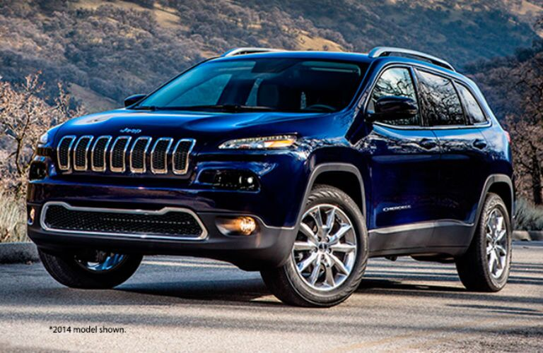 Front exterior view of a blue 2015 Jeep Cherokee