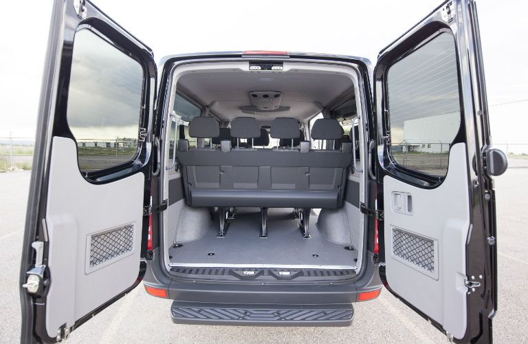 Rear doors of the 2015 Mercedes-Benz Sprinter 2500 passenger van open wide showing its standard cargo area
