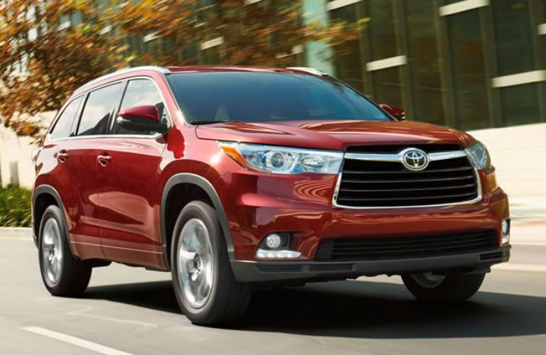 Front exterior view of a red 2015 Toyota Highlander